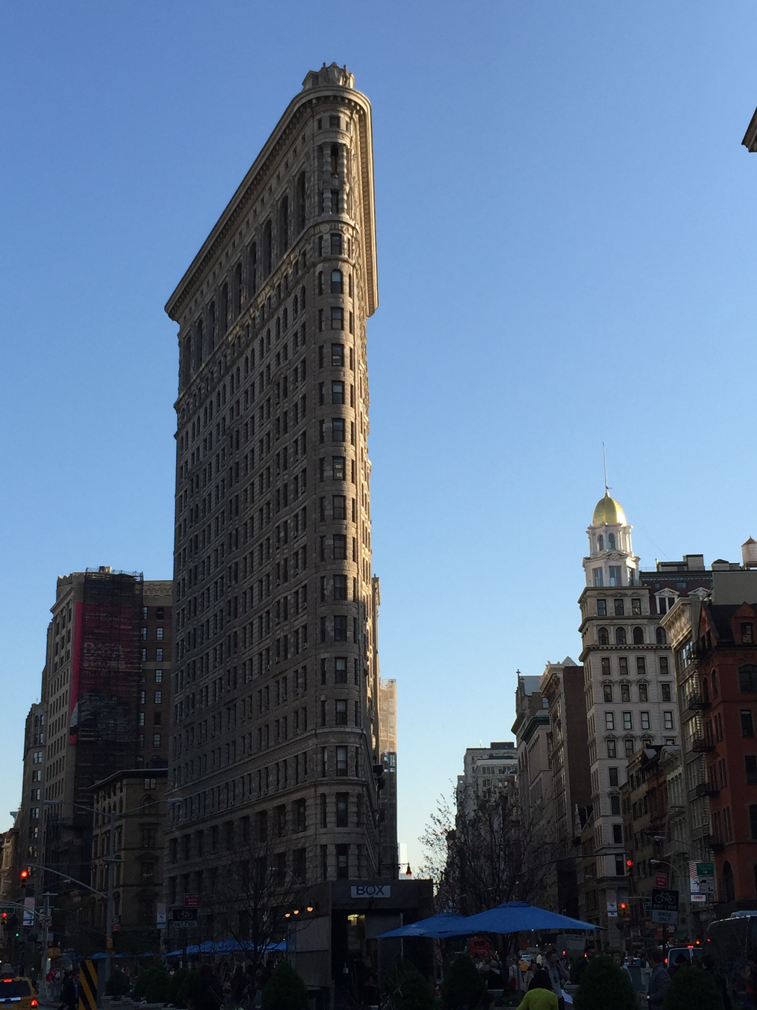 """An afternoon photo of one of NYC's """"Old Faithfuls""""- the Flatiron Building"""